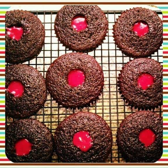 Dark Chocolate Raspberry Curd Filled Cupcakes | The JavaCupcake Blog https://javacupcake.com