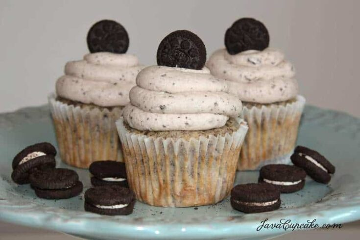 A trio of Oreo cupcakes with Oreo buttercream on a serving plate.