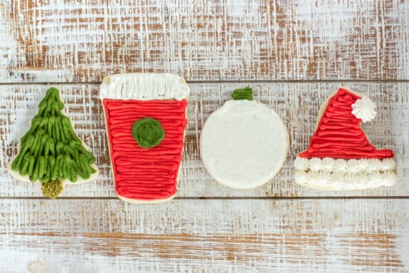 Traditional sugar cookies frosted with buttercream and dressed up for the holiday make these Frosted Sugar Cookies the perfect Christmas treat!