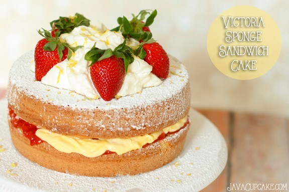 Victoria Sponge Sandwich Cake with vanilla pudding & fresh strawberry filling topped with fresh whipped cream, lemon zest and more strawberry! | JavaCupcake.com