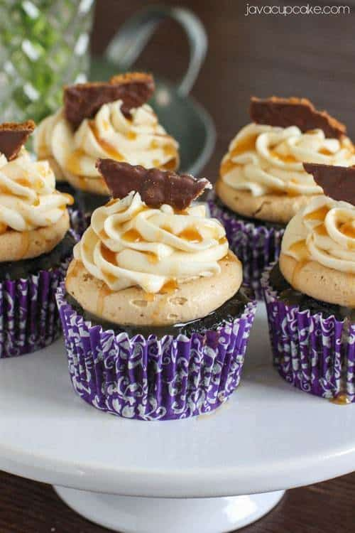 The Most Epic Cupcakes Ever!  Guinness and Chocolate Cupcakes topped with Biscoff Buttercream, Bailey's Irish Cream Buttercream, Caramel Drizzle and a Chocolate dipped Bisocoff Cookie! | JavaCupcake.com