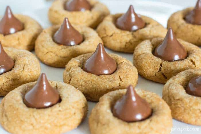 Deluxe Cookie Butter Blossoms - A cookie butter based dough rolled in turbinado sugar and topped giant hazelnut filled chocolates. | JavaCupcake.com