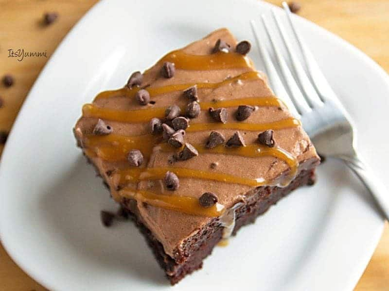 Extreme Chocolate Poke Cake - There are FOUR layers of chocolate in this chocolate lover's dessert, plus a drizzle of sweet caramel on top. Recipe from @itsyummi for JavaCupcake.com