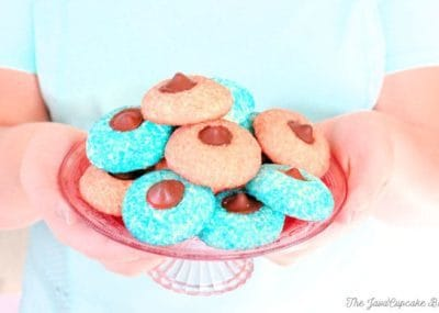 Sugar Cookie Chocolate Thumbprints - Pillowy sugar cookies rolled in sugar crystals with chocolate truffle centers | The JavaCupcake Blog http://javacupcake.com