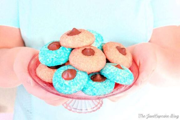 Sugar Cookie Chocolate Thumbprints - Pillowy sugar cookies rolled in sugar crystals with chocolate truffle centers | The JavaCupcake Blog https://javacupcake.com
