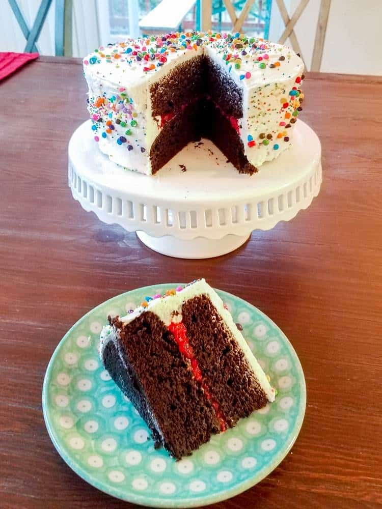 My Favorite Birthday Cake - Espresso Chocolate Cake filled with Raspberry and topped with Whipped Vanilla Buttercream | The JavaCupcake Blog http://javacupcake.com