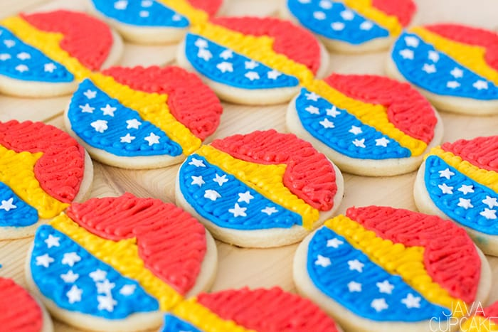 Wonder Woman Cookies - Soft sugar cookies topped with buttercream decorated as my favorite super hero, Wonder Woman!   The JavaCupcake Blog https://javacupcake.com