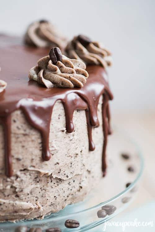 chocolate ganache drips on a mocha cookies and cream cake