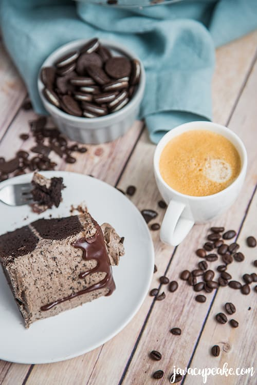 slice of mocha cookies and cream cake and a cup of coffee
