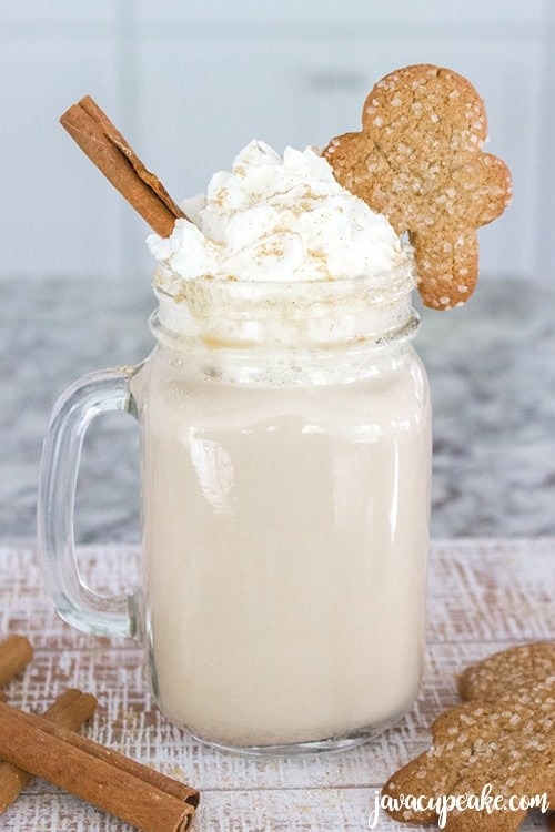Spiced Gingerbread Coffee served with gingerbread cookies and cinnamon sticks.