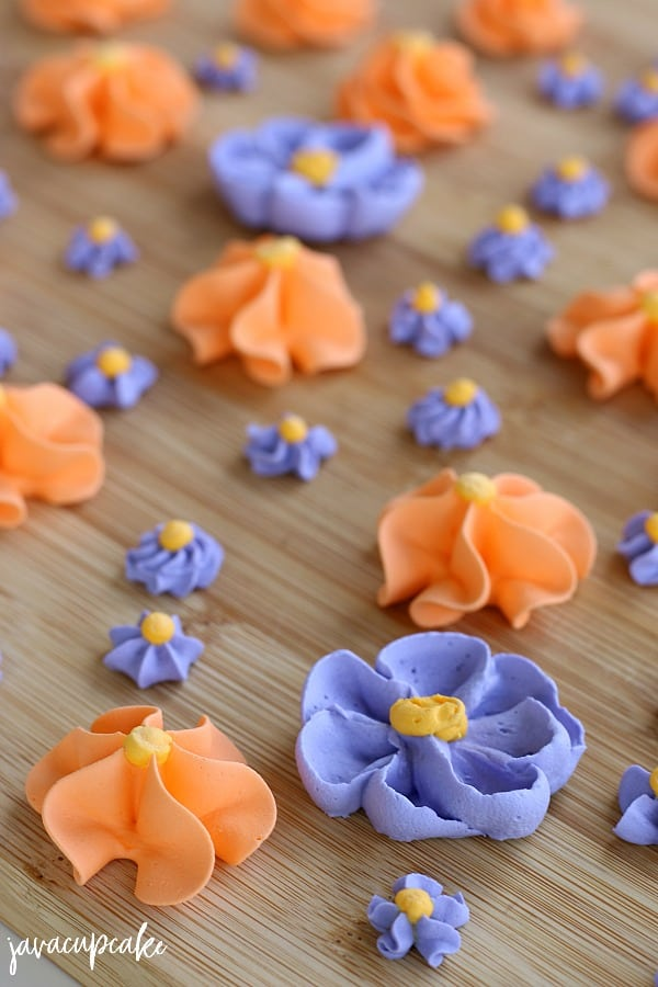 Royal Icing flowers in purple and orange