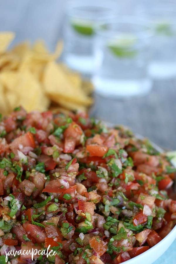 homemade tomato salsa in white bowl with chips