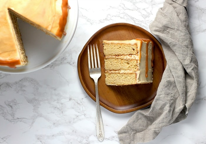 A slice of layer cake made from a caramel cake recipe