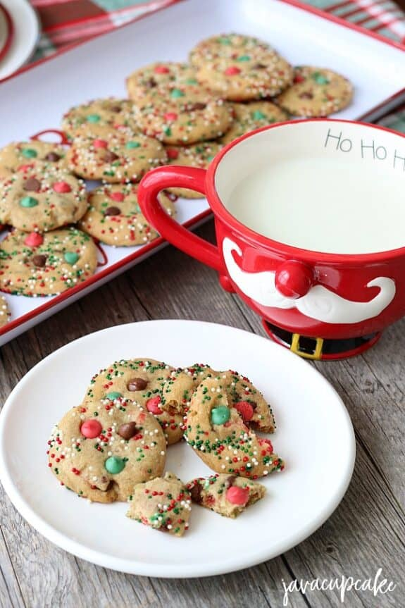 Christmas Chocolate Chip Cookies served on a plate along with milk.