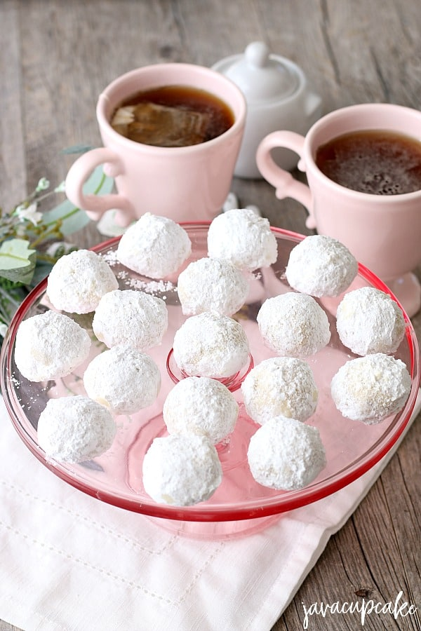 Russian tea cakes served with hot tea, perfect for afternoon tea.