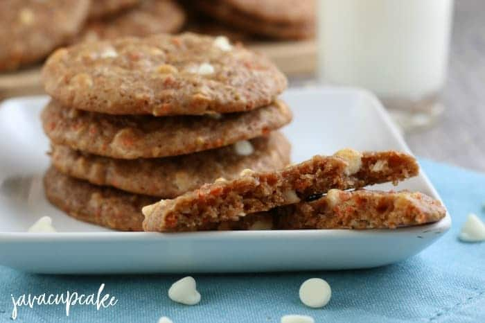 Landscape view of carrot cake cookies on a white plate.